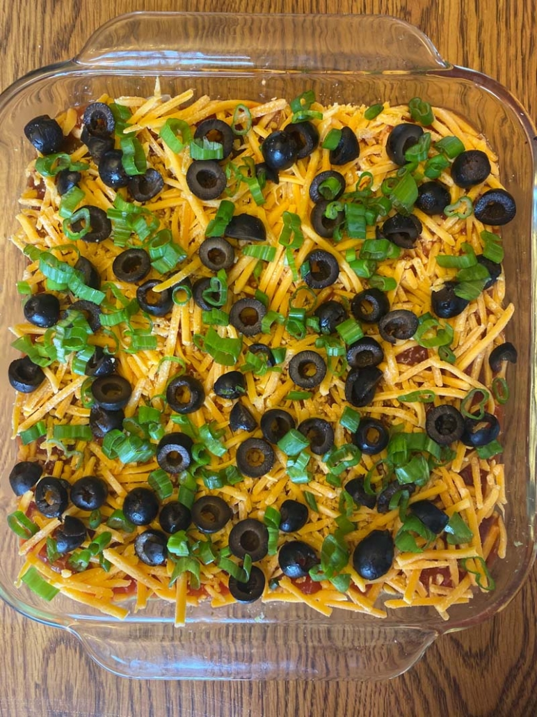 shredded cheese, olives and green onions