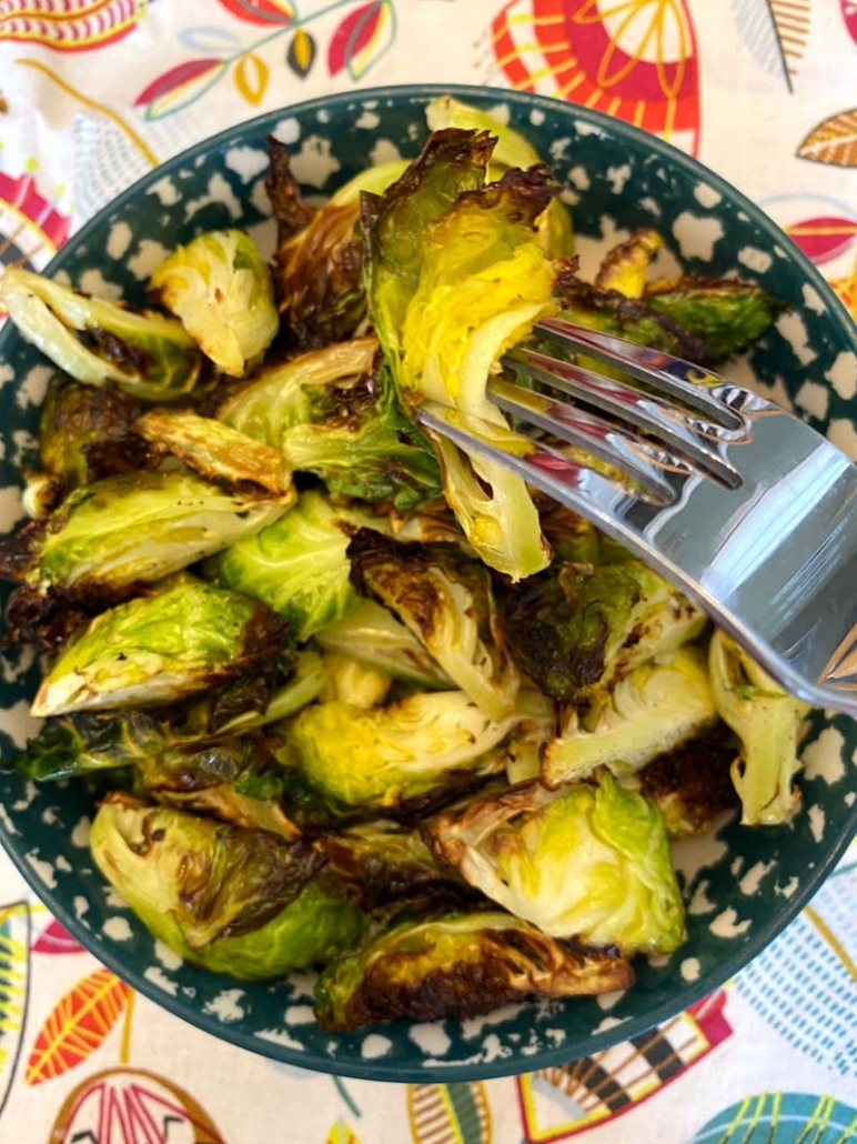 eating fried brussel sprouts with a fork