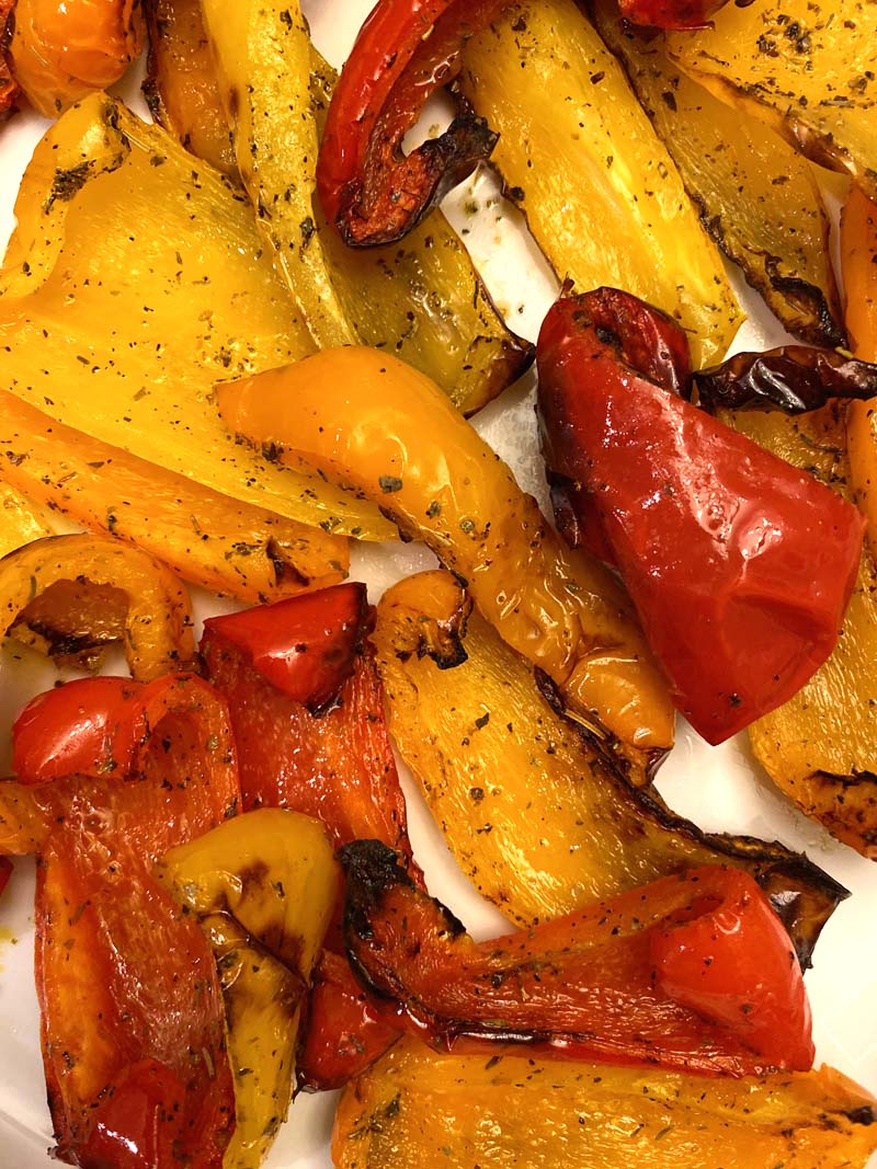 Close up shot of red, yellow, and orange bell peppers that were roasted in an air fryer.