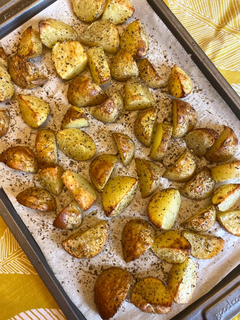 roasted potatoes with skins on a baking sheet