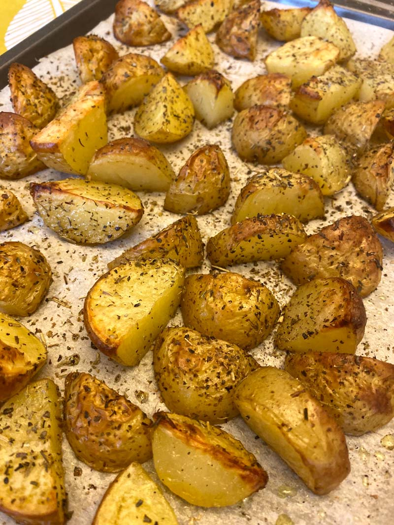 Baking sheet of roasted potatoes with skins