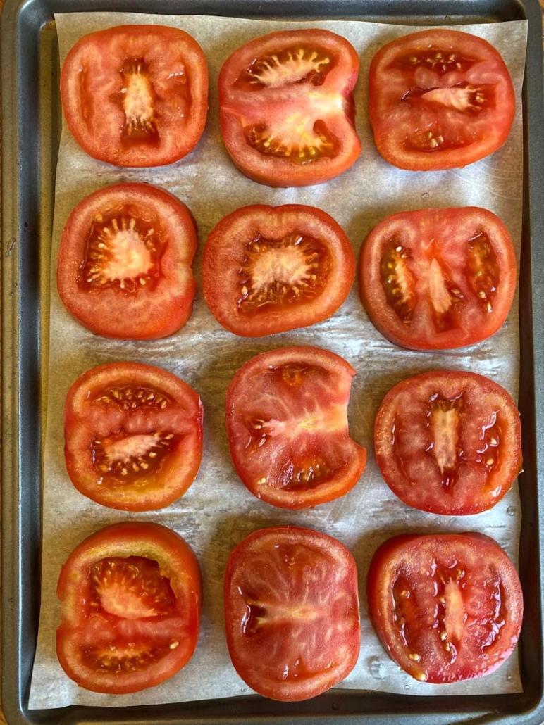 tomato slices on a baking sheet