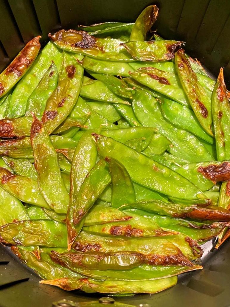 air fryer roasted snow peas in an air fryer basket