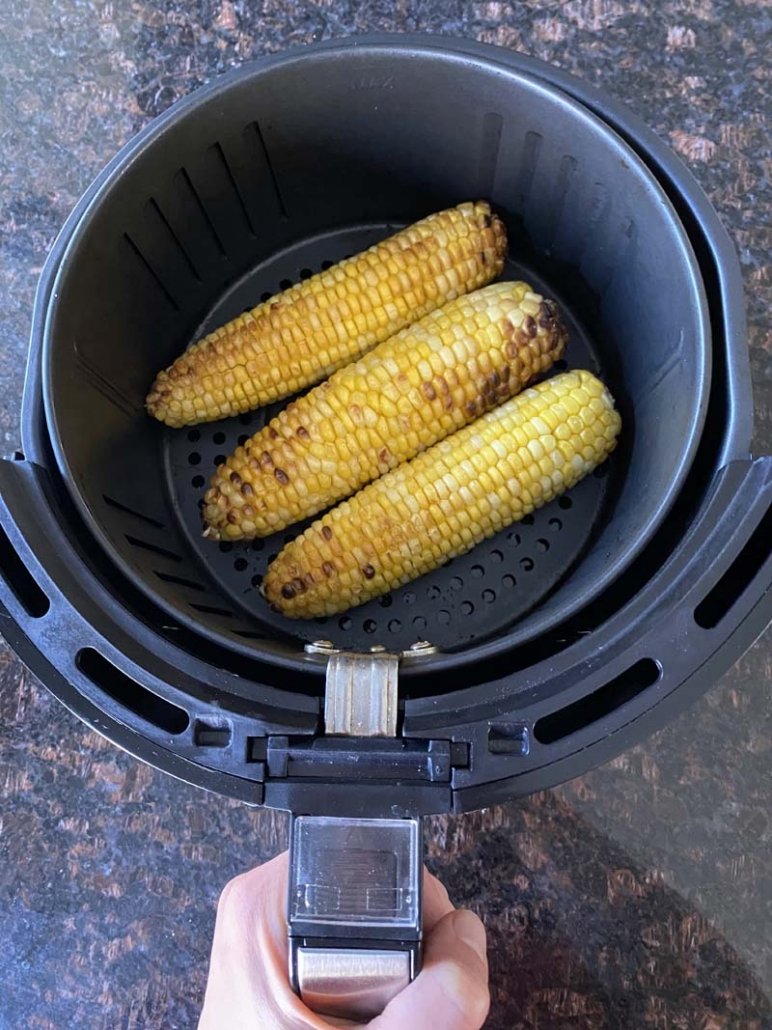 cooked corn on the cob in an air fryer basket