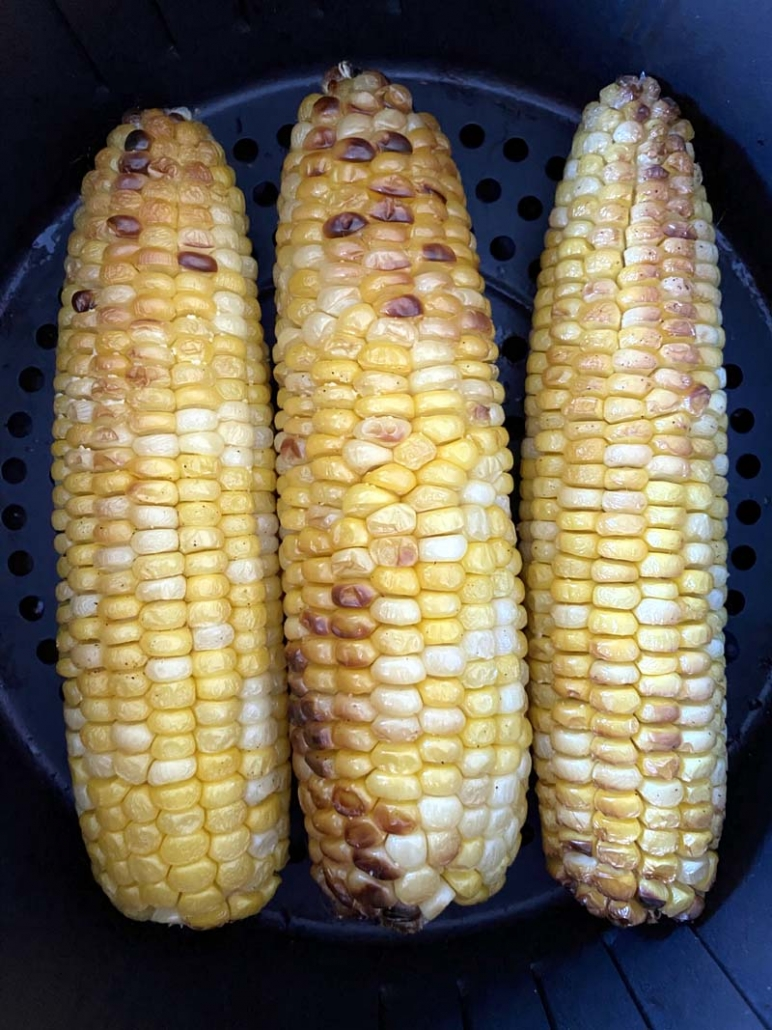 air fryer corn on the cob in an air fryer basket