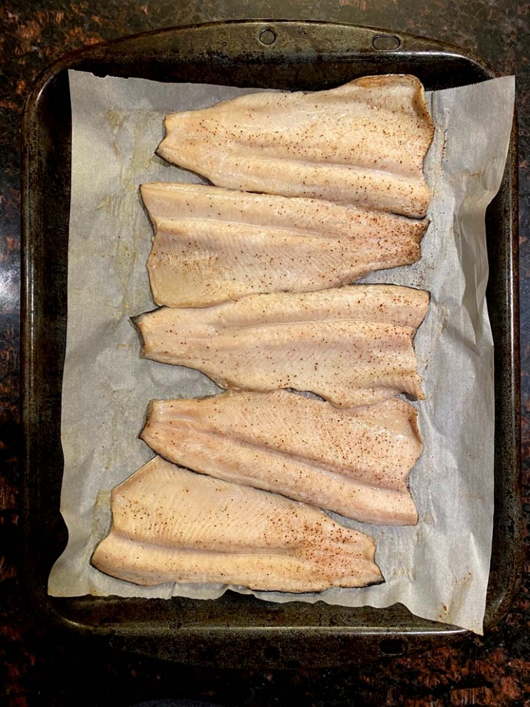 baked rainbow trout on a baking sheet