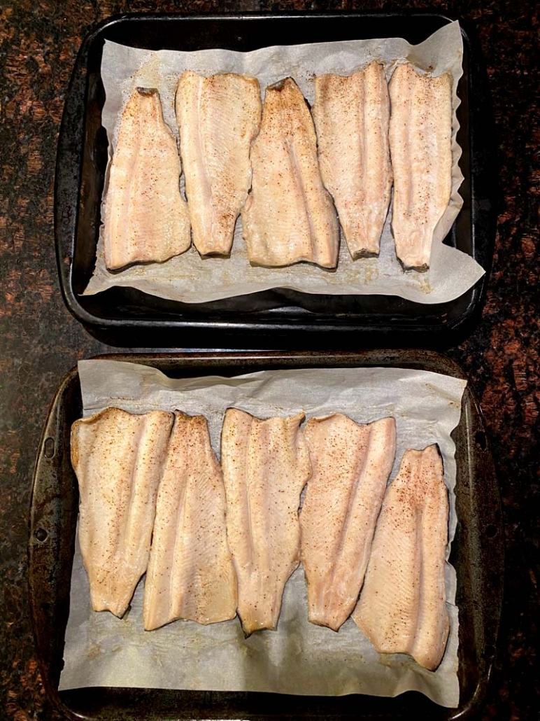 two baking sheets full of oven-baked rainbow trout