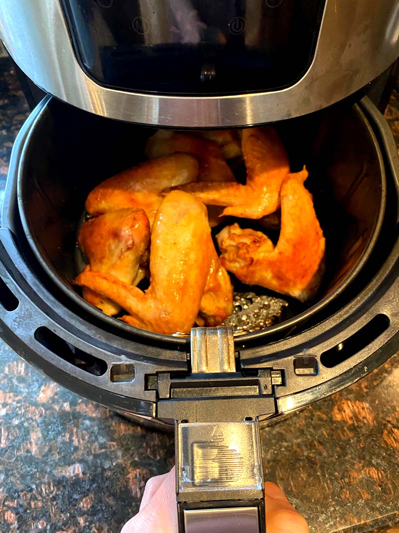 Taking the basket out of the air fryer