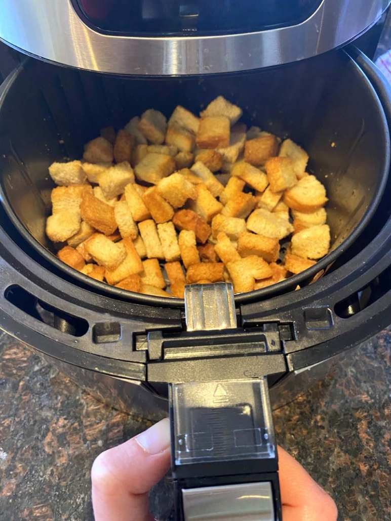 baked croutons in an air fryer basket