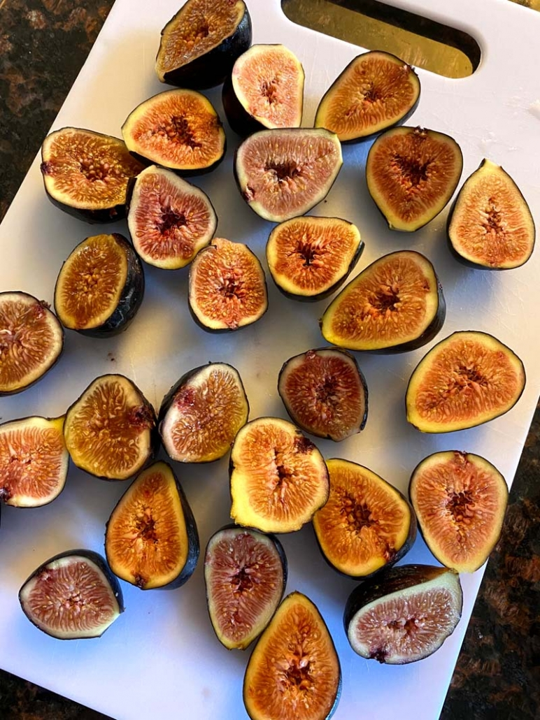 prepping and cutting fresh figs to be cooked