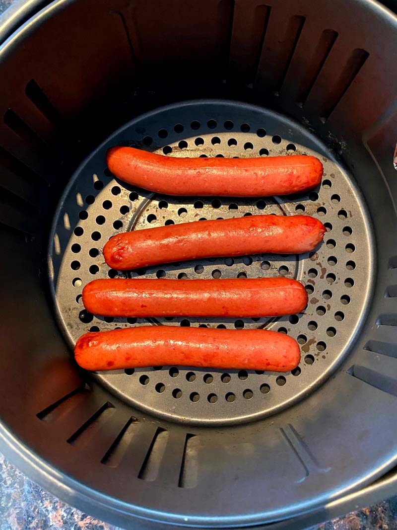 The sausages in the air fryer basket