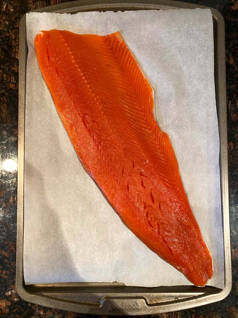large salmon fillet on a baking sheet