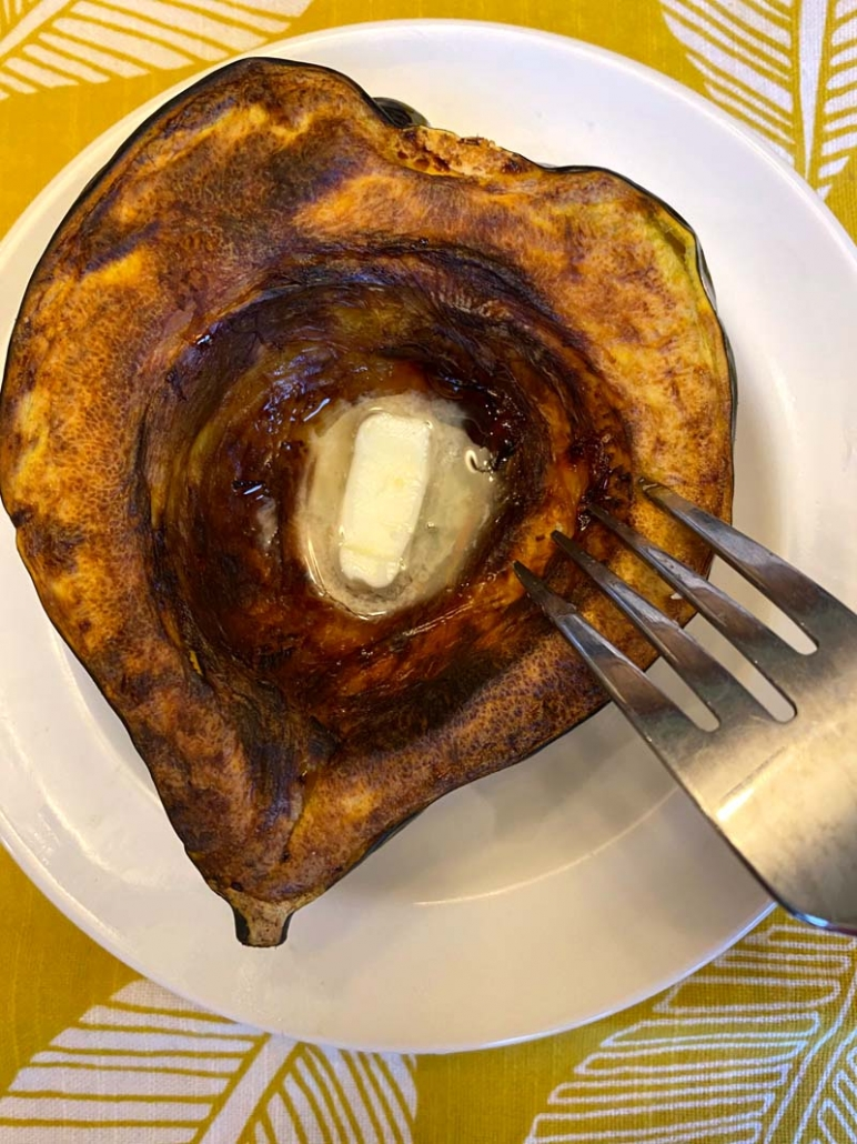 roasted acorn squash half on a plate