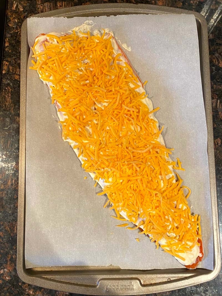 salmon sprinkled with shredded cheddar cheese