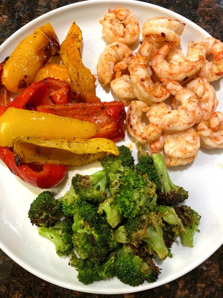air fried shrimp served with roasted bell peppers and roasted broccoli