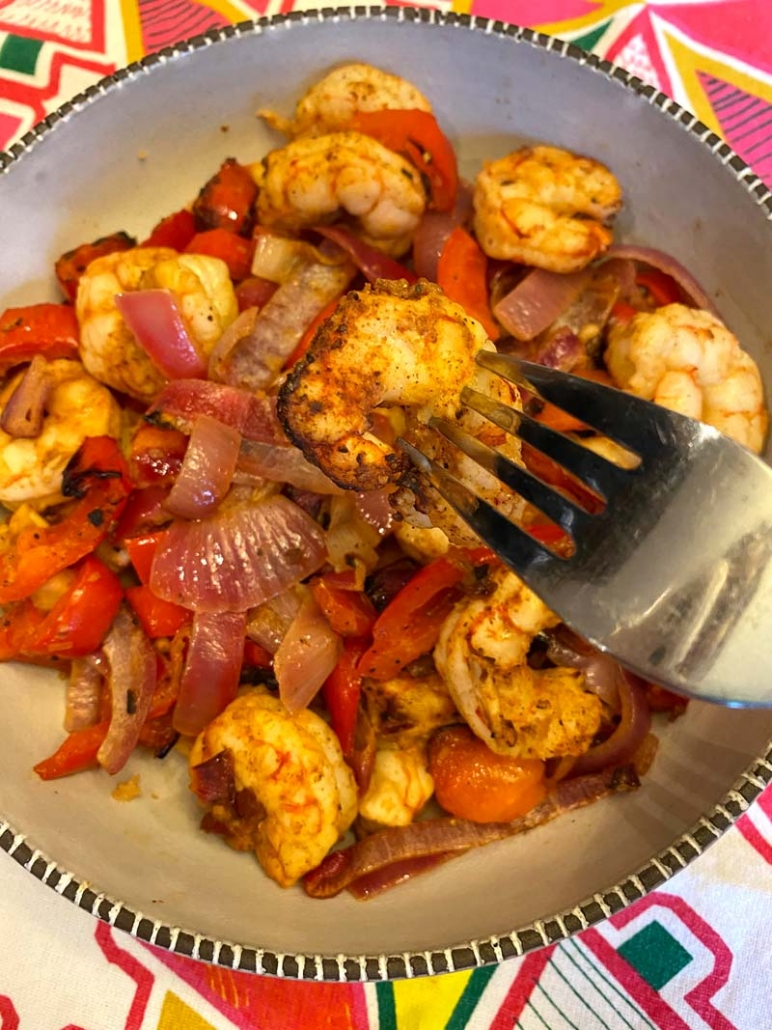 Eating air fried shrimp fajitas with a fork