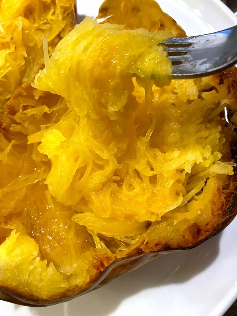 eating spaghetti squash with fork