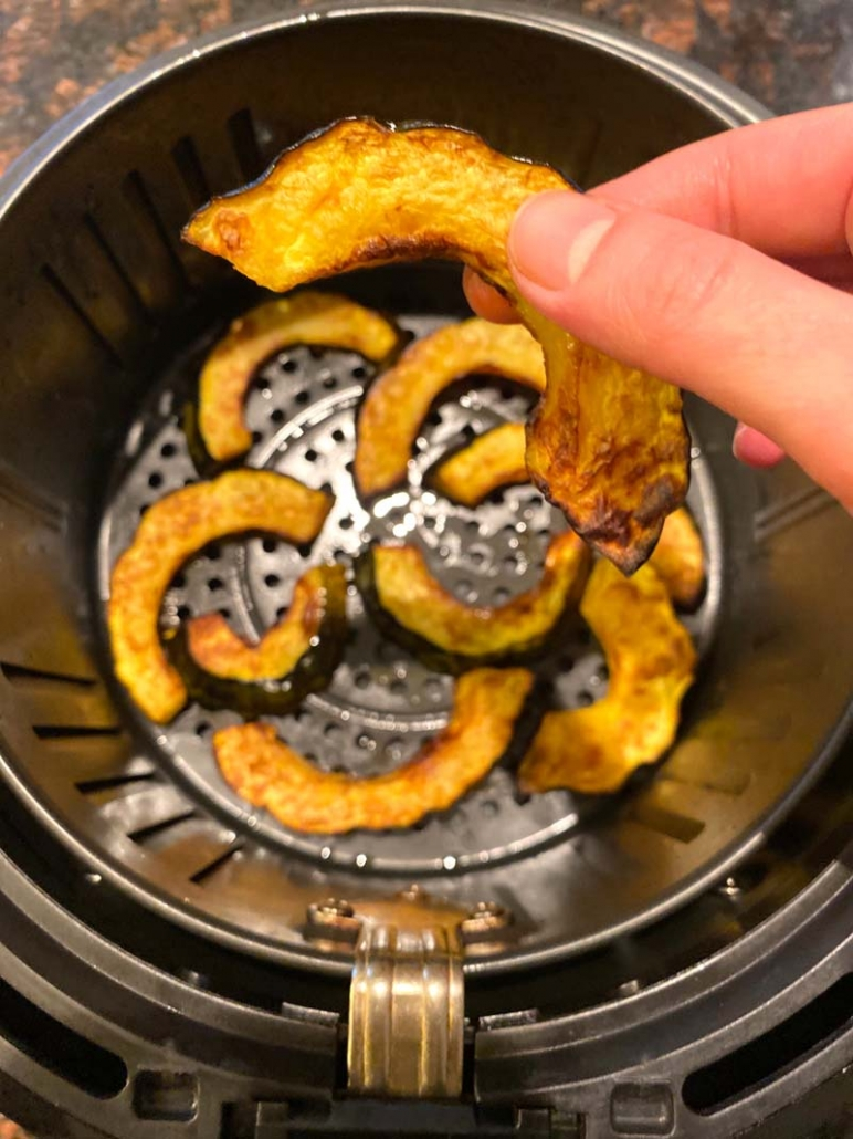 eating air fried acorn squash fries