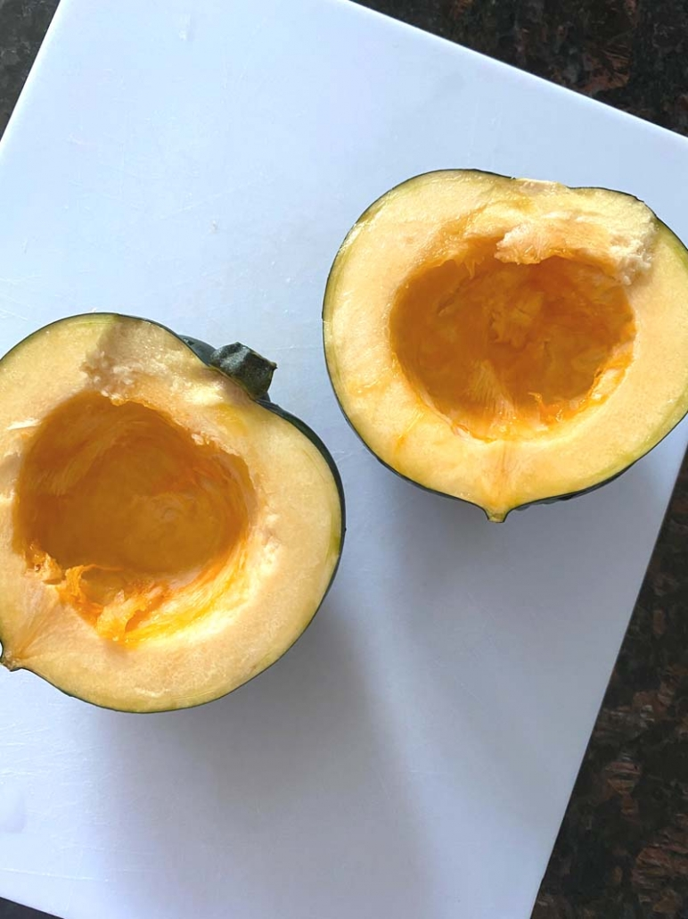 halved acorn squash with scooped out centers