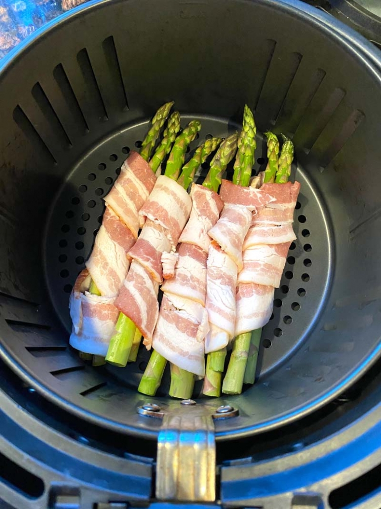 cooking asparagus wrapped with bacon in an air fryer