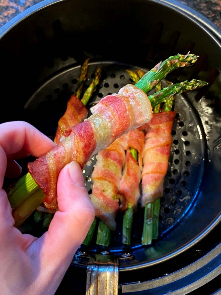 2 asparagus spears wrapped in bacon