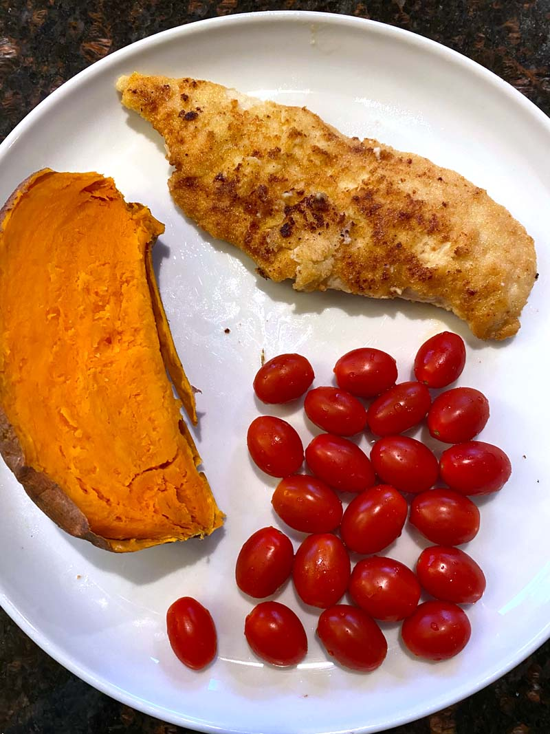 Almond flour chicken served with a sweet potato