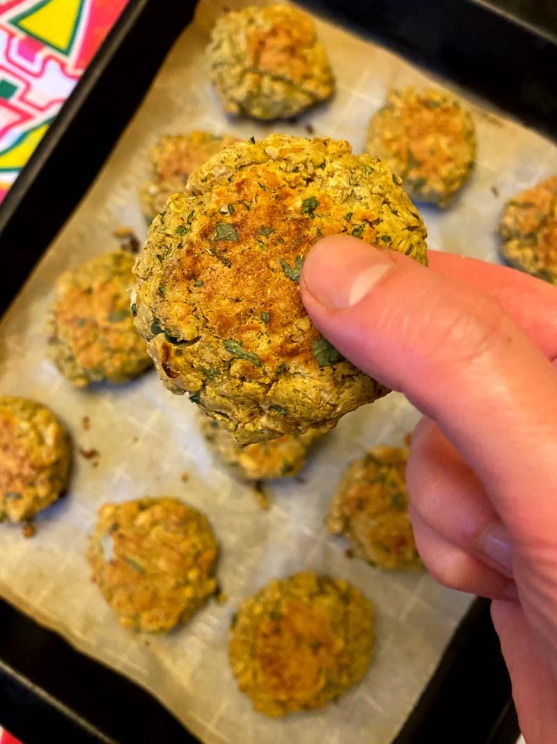 holding a baked falafel