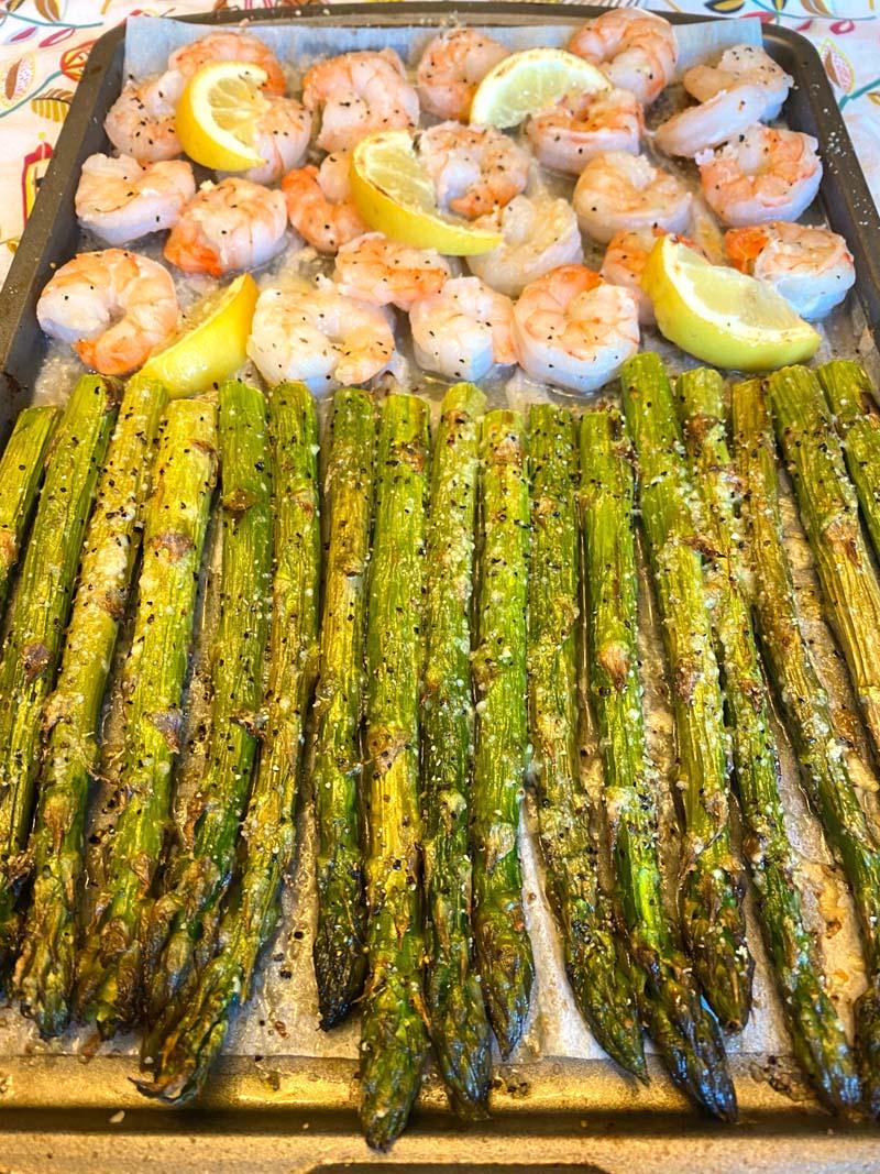 shrimp and asparagus on a sheet pan