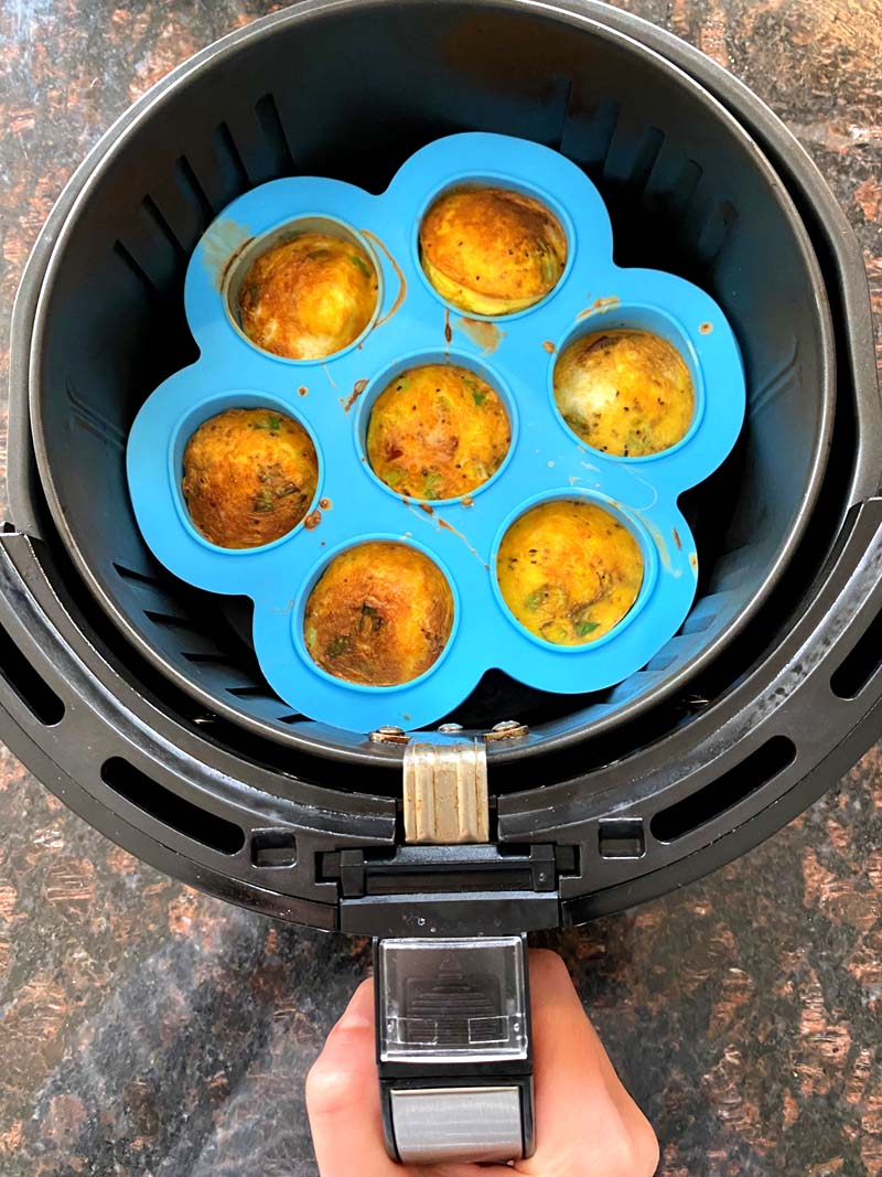 Removing the egg bites from the air fryer