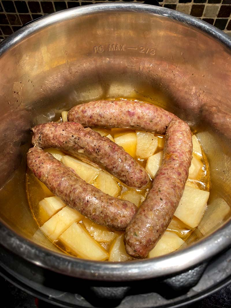Potatoes and sausages in a pressure cooker