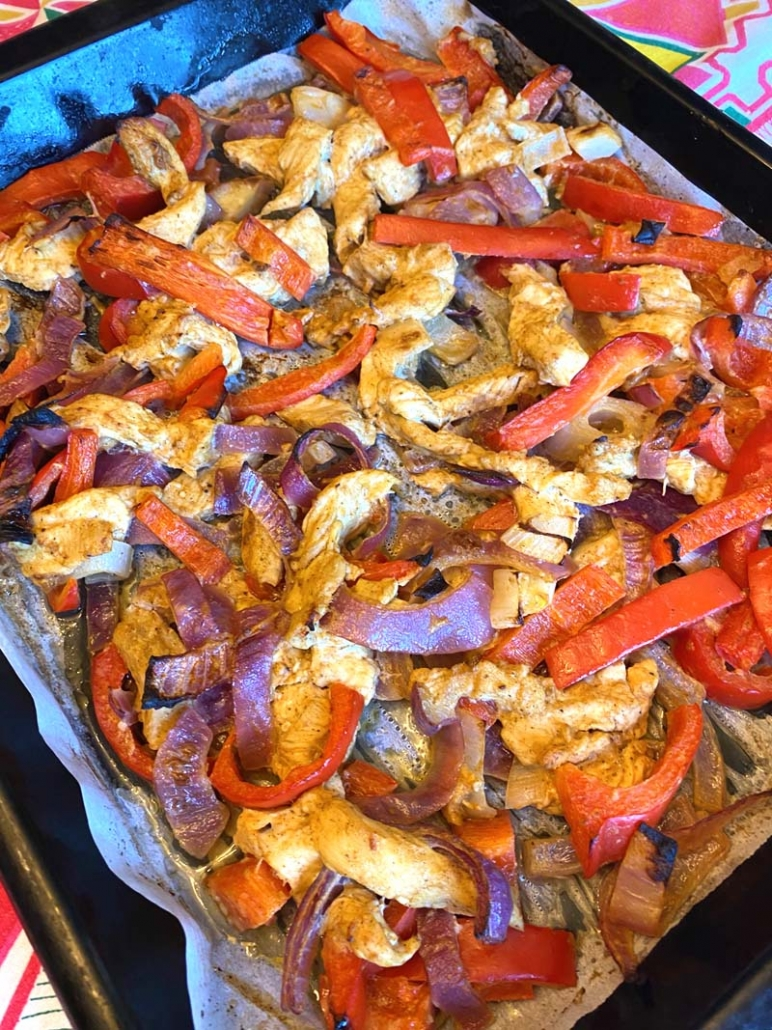 chicken fajitas baked on a sheet pan
