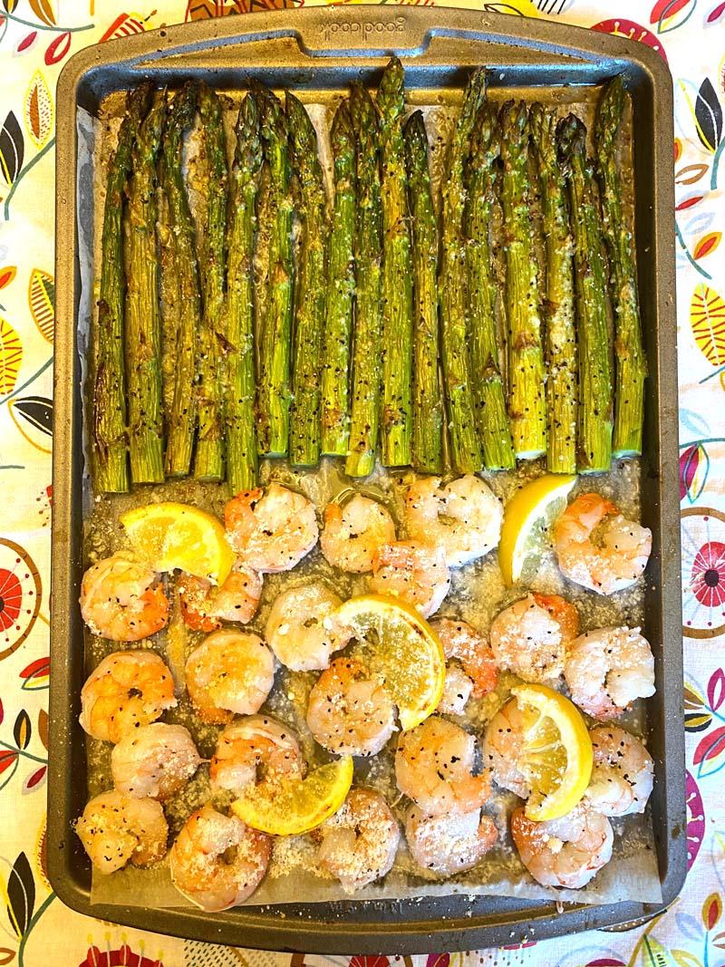 Overhead shot of shrimp and asparagus on a sheet pan