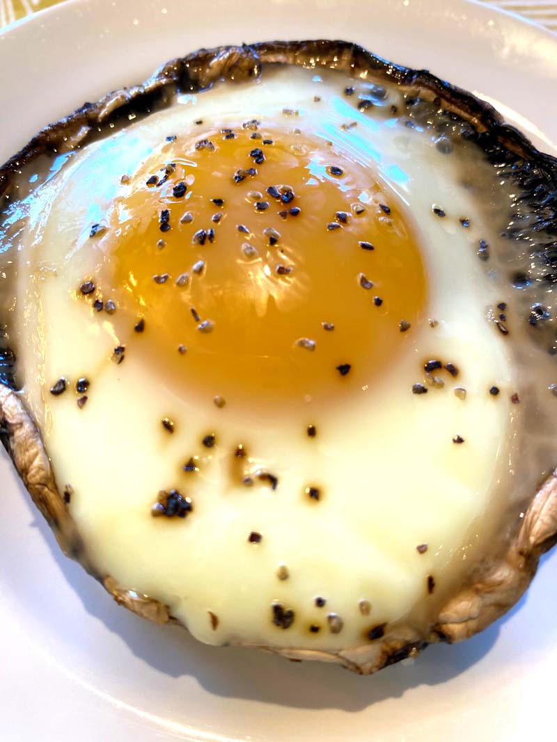 Close up of a portobello with baked egg
