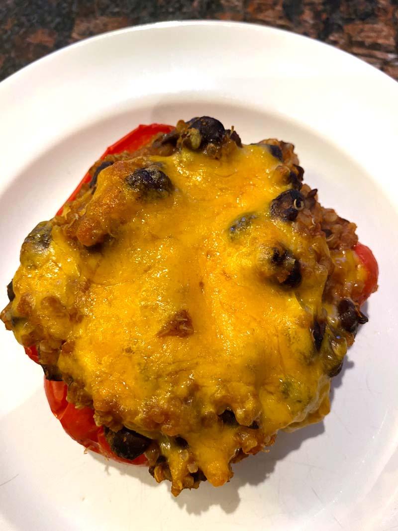 A vegetarain stuffed pepper on a white plate