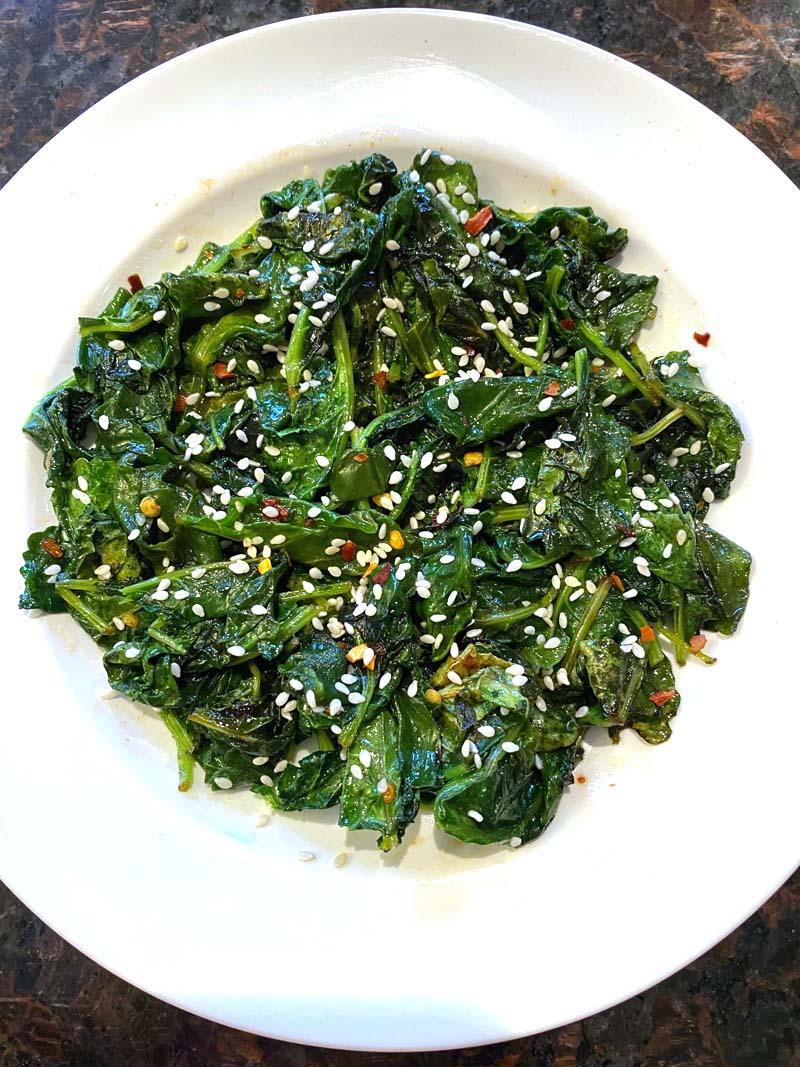 Sautéed sesame kale in a white bowl