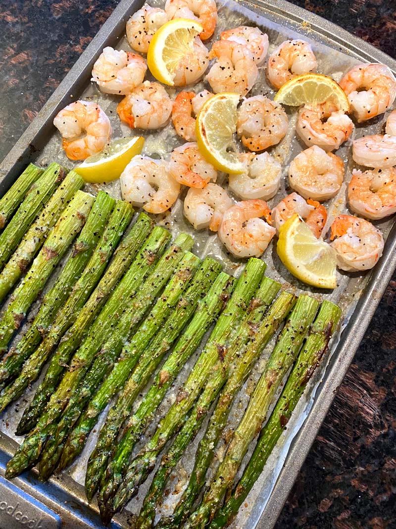 shrimp, lemon and asparagus on a sheet pan