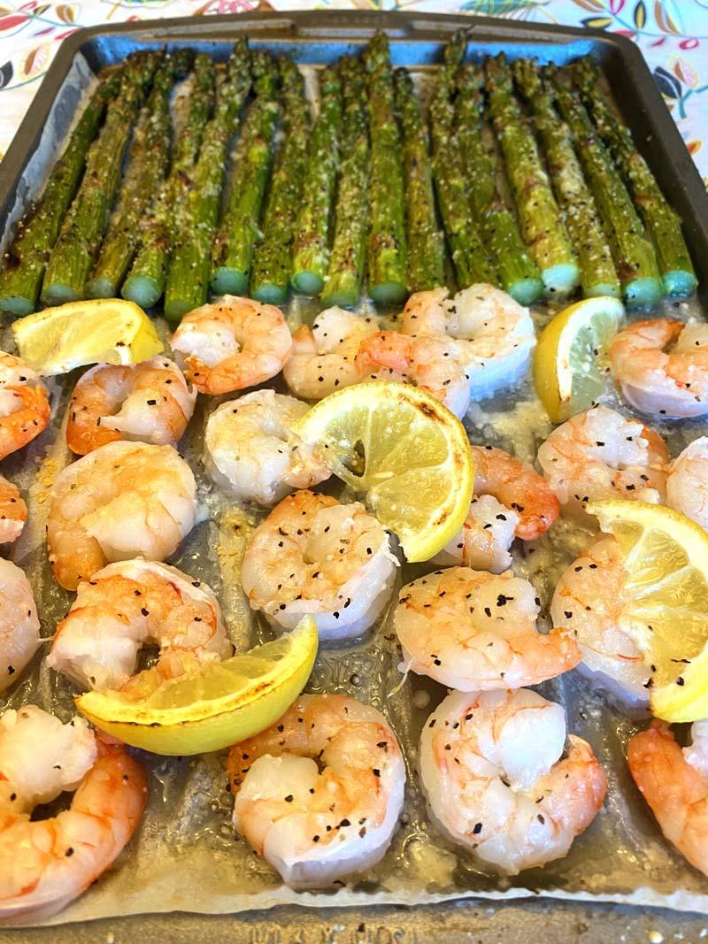 The seasoned shrimp on a sheet pan