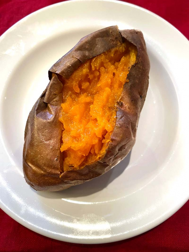 baked sweet potato on a white plate
