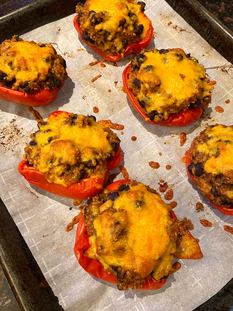 The cooked stuffed peppers on a baking sheet