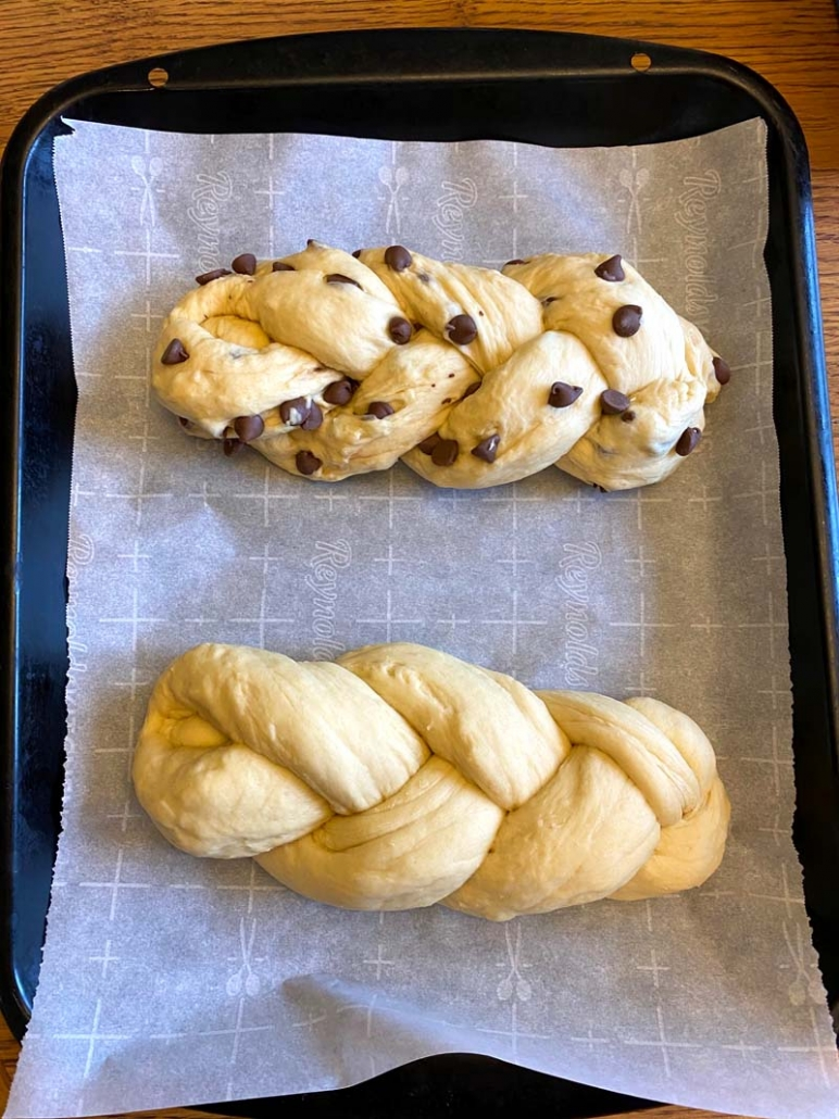 two loaves of challah bread and one with chocolate chips