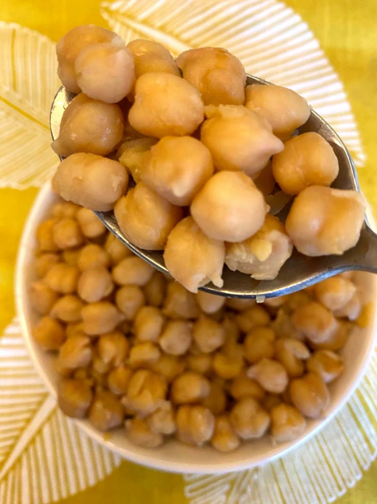 scooping a spoonful of cooked chickpeas