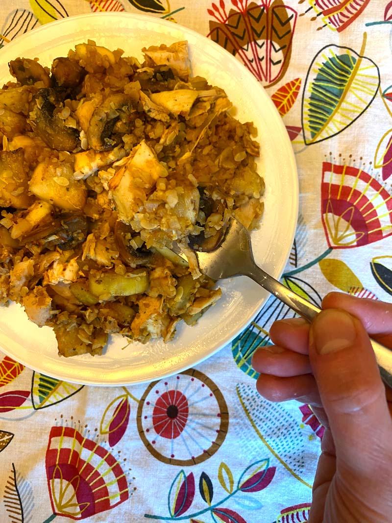 A fork in the cauliflower rice stir fry