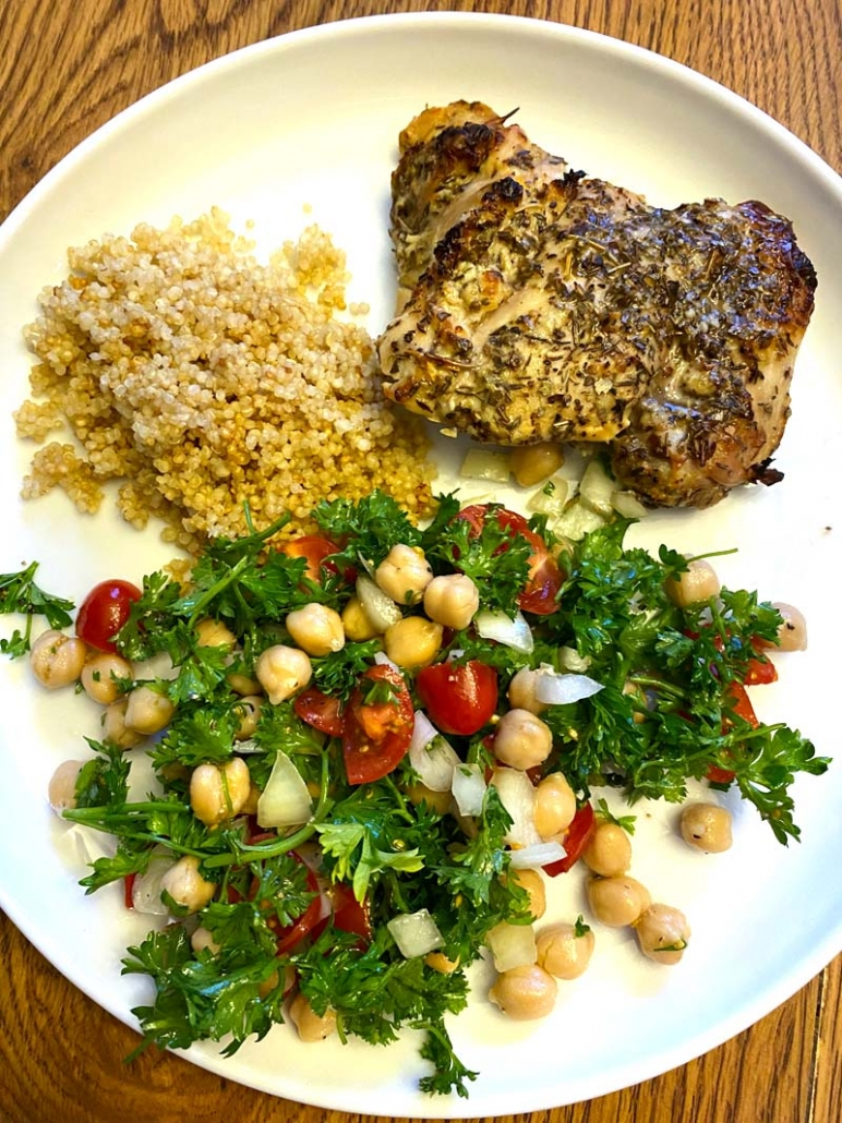 greek lemon chicken thighs with quinoa and tomato cucumber salad