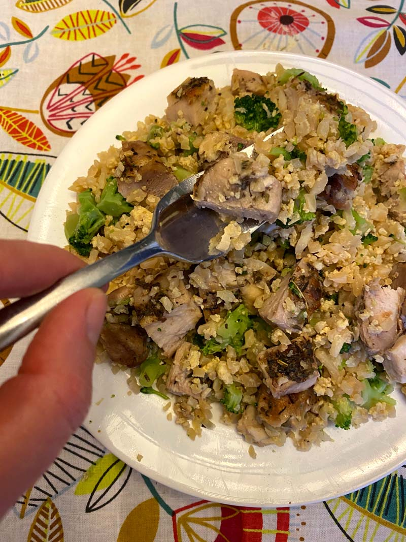 forkful of chicken cauliflower fried rice