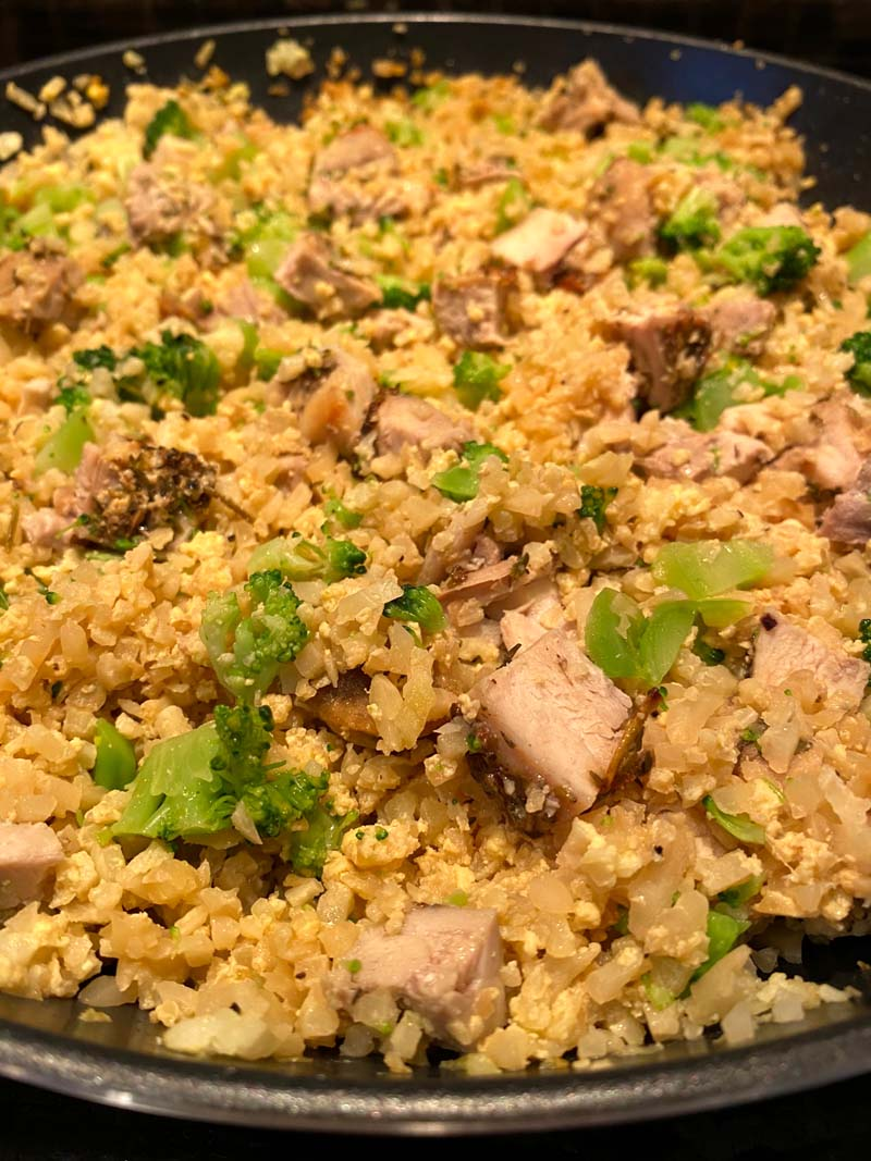 close up of chicken cauliflower fried rice in a pan