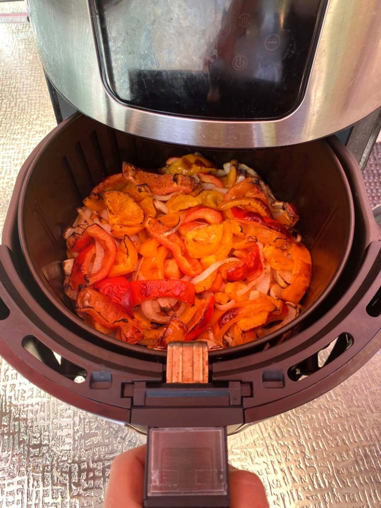cooking red and orange bell peppers and onions in air fryer