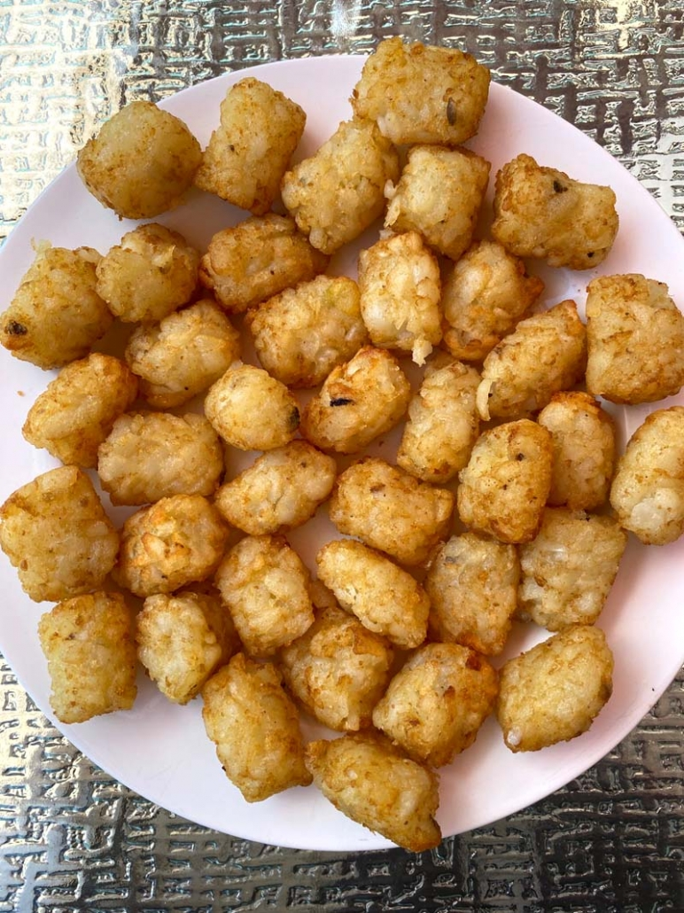 air fryer tater tots served on a white plate