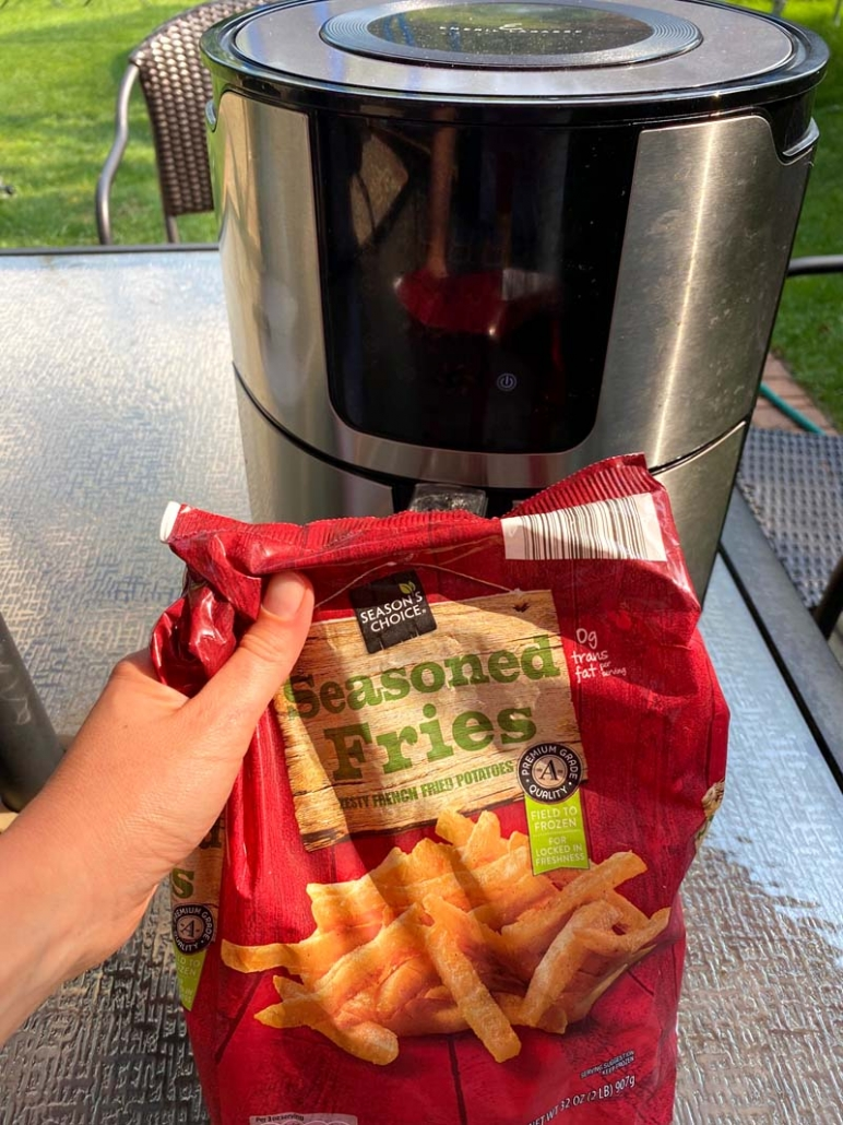 a bag of seasoned frozen french fries and an air fryer