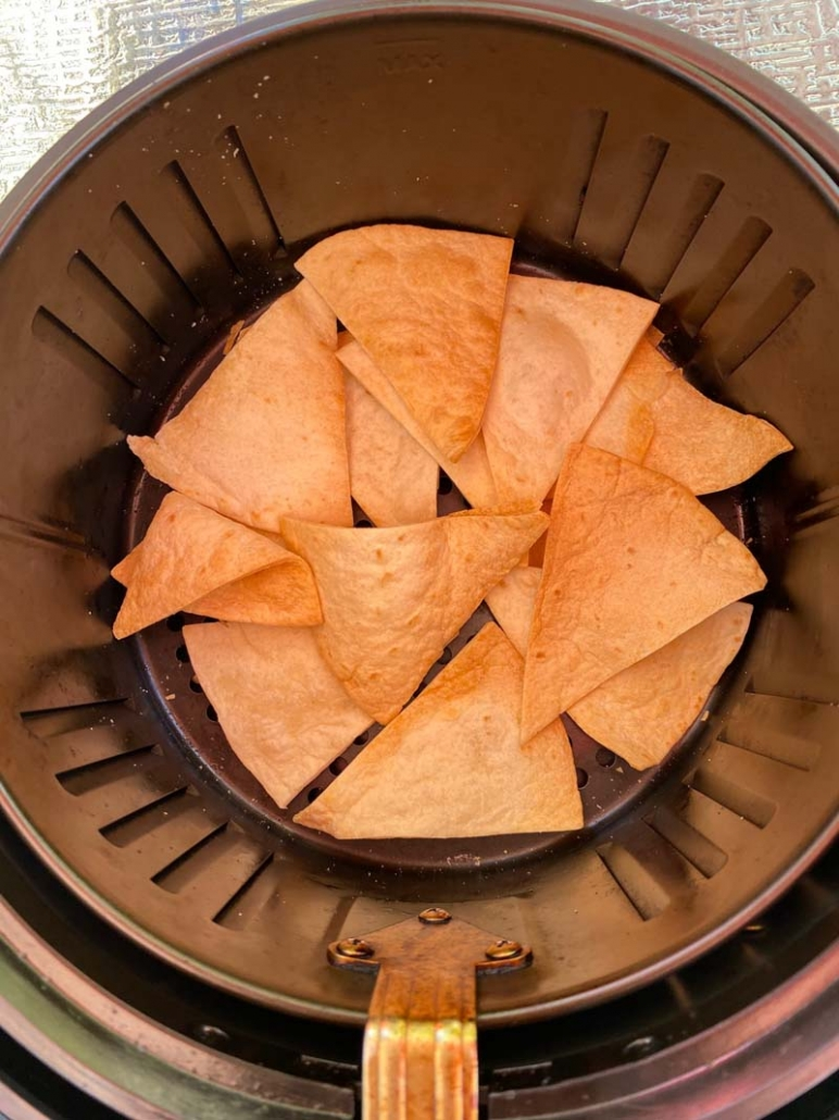 homemade tortilla chips in an air fryer basket