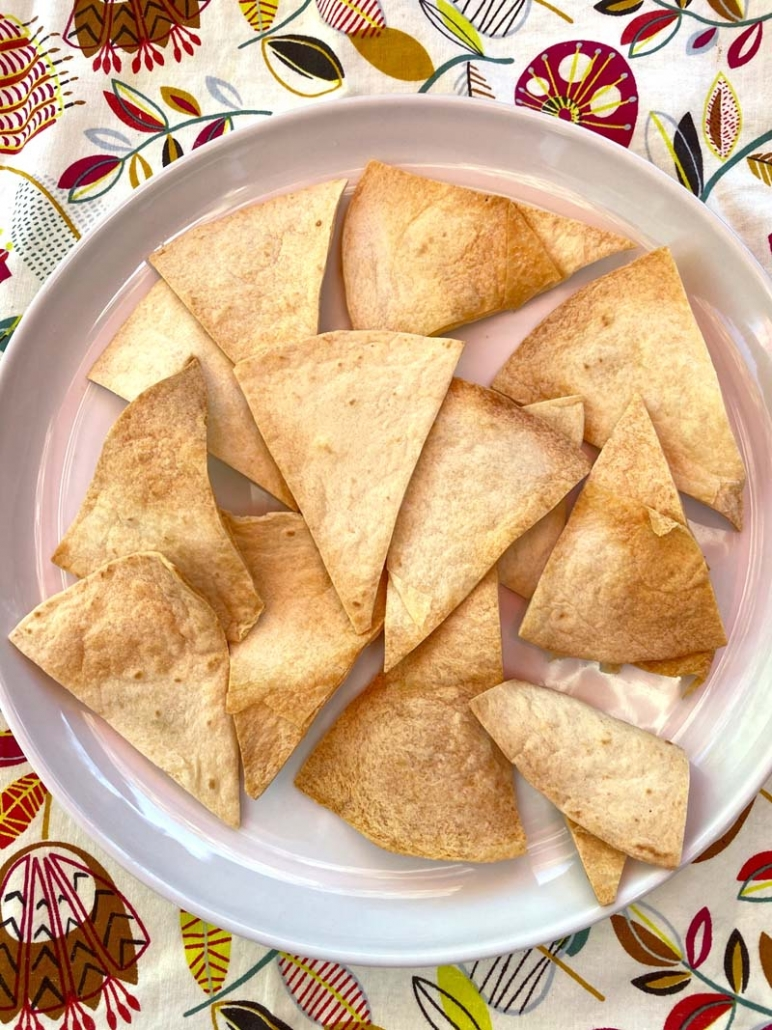 A plate of crispy homemade tortilla chips